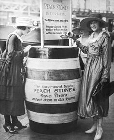 New York, New York. August 24, 1918. Two young women oontribute to the drive to gather peach pits which are ground up to a charcoal powder and used to filter the poison out of gas warfare.