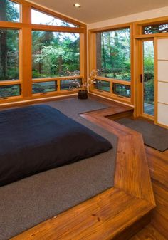 I love he wooden window frames, and small windows that open along the floor
