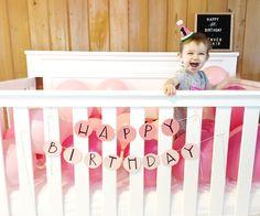 #firstbirthday #crib #birthday #balloons #partyhat #pink #babygirl #denverblair #happybirthday