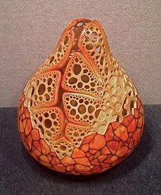"Gourd Artwork - ""Fire Bowl #3"" 18"" in diameter. Carving by Mark Doolittle; paper collage by Kathy Doolittle."