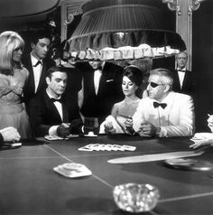A scene from the James Bond film 'Thunderball' with Sean Connery, Claudine Auger and Adolfo Celi. (Photo by MacGregor/Getty Images)Image provided by. Sean Connery, James Bond, Casino Theme Parties, Casino Party, Casino Night, Claudine Auger, Casino Costumes, B Roll, Wall Art Wallpaper
