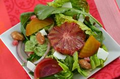 Mixed Greens with Roasted Beets, Blood Oranges, Pomegranate Seeds and Candied Almonds