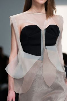 Sheer dress with cut outs & peeling layers; delicate deconstructed fashion details // Hussein Chalayan