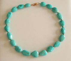 Faceted Sleeping Beauty turquoise nugget necklace with 14k gold beads and 14k gold clasp.
