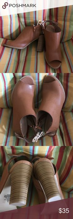 Express Brown Open toe Booties NWOT Brand new never worn. Only flaw is light scuffing/ scratches on the back of the heels hardly noticeable Express Shoes Ankle Boots & Booties