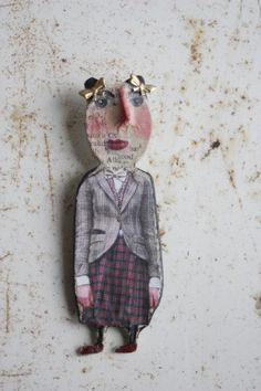 Iris by Julie Arkell petite flatsy-style papier mache dollie, one of a kind and made with papers, metals and found objects, can be worn as a pin