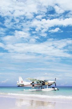 Blissful scene of a Cessna 208 Seaplane and the perfect beach.