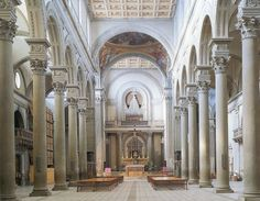 """This is the interior of the Church of San Lorenzo in Florence designed by Brunelleschi. He used pietra serena, """"the serene stone,"""" to help create the calm sense of balance and I find it breathtaking."""