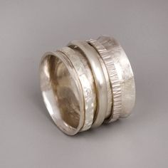 Sterling Silver Spinner Ring - Thin Silver Spinner Band. $195.00, via Etsy.