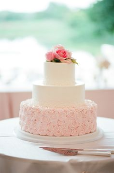 Pretty pink rosette cake: http://www.stylemepretty.com/vault/gallery/38388 | Photography: Tamara Gruner - http://tamaragruner.com/