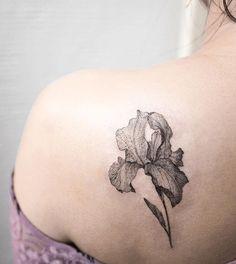 Iris tattoo on the shoulder blade.
