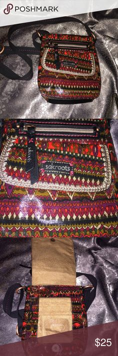 """Sakroots artist circle small Crossbody boho chic Sakroots purse, crossbody Artist Circle Peace, Red multicolor pattern purse  Red /multi-color Coated Canvas ~Flap Closure with magnetic snap ~one magnetic snap flapped compartment also on front flap ~one compartment under flap: compartment has 2 slip pockets one one side , zippered pocket on other side .  plus room for other items ~44"""" adjustable strap FOR A SMALL PURSE THIS HOLDS ALOT!!! perfect purse for festival, travel, vacation, eurotrip…"""