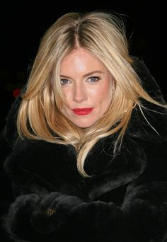 Simple make-up with red lips...and tossled hair! maybe I just like Sienna Miller... but more so for the fact that she dated Jude Law...