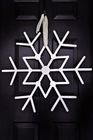 Popsickle stick snowflake. Use white glitter with a little silver or blue.