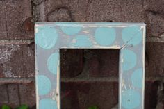 Distressed Picture frame with a 4x6 opening.  Distressed Blue and grey Wooden Frame with polka dots on the top and stripes on the side