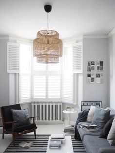 Wooden window shutters from Hillarys - light living room inspiration - window treatments - scandi-style interiors