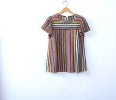b084e91689 A similar version of a Vertical Striped 70s style shirt Britt wore while  doing a photoshoot