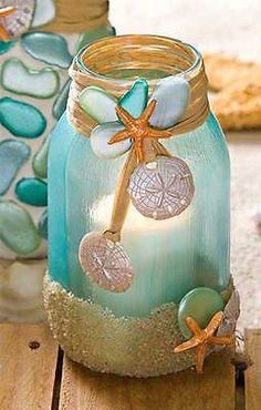This jar was painted with Mod Podge Sheer Colors, and (real) sand was added at the bottom with Mod Podge.  Make your embellishments with Mod Molds and Melts, then paint. Let dry and attach to the jar with glue and raffia. Add a candle to turn into a lantern!