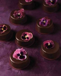 Tiny chocolate cakes with pansies http://www.marthastewartweddings.com/404639/wedding-cakes-with-flowers?socsrc=soc_pin_2015_12_2_WeddingCakes_Scale_Nocost_AD_Galleries&crlt.pid=camp.ln8IMY6sB7FB#401855