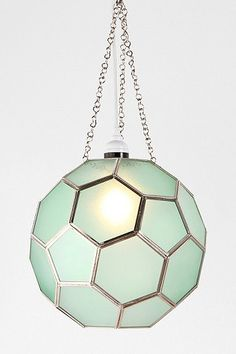 Honeycomb pendant light + TIPS to decorate with geometric shapes in lighting.