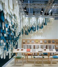 Hanging fabric strips in varied colors. Kvadrat fabric installation by London-based Yael Mer & Shay Alkalay of Raw Edges Studio at Stockholm Furniture 2013 Display Design, Booth Design, Store Design, Display Ideas, Banner Design, Exhibition Stand Design, Exhibition Display, Fabric Installation, Ceiling Installation