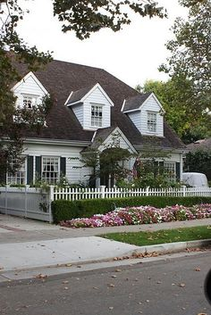 House of Marlowe: Exteriors: The White Picket Fence; i like the front fence set in from sidewalk so that you can plant bushes and ground covering
