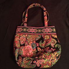 VERA BRADLEY handbag in Symphony in Hue This was one of my favorite patterns they have come up with. I barely got to use the purse and I'm sad that it's time to part with this beautiful array of colors handbag. The purse has pockets in the scrunched style part in the front and a wide internal pocket! Very hard to find this style anymore Vera Bradley Bags Shoulder Bags