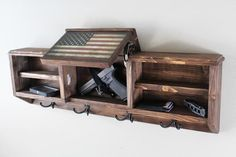 Rustic Coat Rack with Hidden Gun and EDC compartment Woodworking Furniture, Woodworking Projects, Hidden Gun Cabinets, Hidden Gun Storage, Hidden Gun Rooms, Rustic Coat Rack, Hidden Compartments, Diy Wood Projects, Lathe Projects