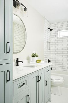Oil rubbed bronze pulls accent a blue gray bath vanity topped with a white quartz countertop contrasted with an oil rubbed bronze faucet. Bathroom Renos, Bathroom Faucets, Bathroom Ideas, Blue Bathroom Vanity, Blue Vanity, Budget Bathroom, Bathroom Renovations, Vanity Faucets, Mint Bathroom
