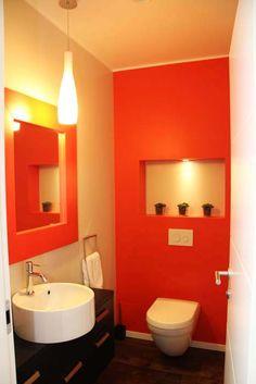 red walls bathroom, red mirror