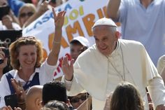Pope Francis greets the crowd during a general audience last month. (CNS/Paul Haring)