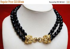 Black Glass Bead Necklace with Gold lion by serendipitytreasure