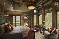 Country Master Bedroom with Ultimate Accents Astoria End Table, Pottery Barn Bradford Bed, stone fireplace, French doors