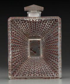 R. Lalique clear glass with sepia enamel La Belle Saison perfume for Houbigant, C. 1925.