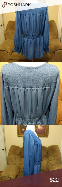 Denim 24/7 Blouse Top Button Down 18W Blue Sheer Denim 24/7 Sz 18W Sorry for the variations of colors in the pictures. The first picture of the back is probably the closest...  Beautiful, flowy, blouse. Smocked across the top, front and back. The end of each sleeve. And at the waist starting at each side and across the back to allow for stretch. Mildly sheer fabric. Button down the front with an extra button sewn into the inside. 100% Polyester Great, gently used condition. No noticeable…