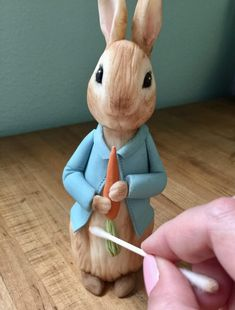 Learn how to create a Peter Rabbit figurine out of modeling chocolate with this tutorial; perfect for a Peter Rabbit themed cake. Peter Rabbit Figurines, Peter Rabbit Cake, Peter Rabbit Birthday, Peter Rabbit Party, Fondant Cake Toppers, Fondant Figures, Fondant Cupcakes, Fondant Rabbit, Baby Boy Birthday Cake