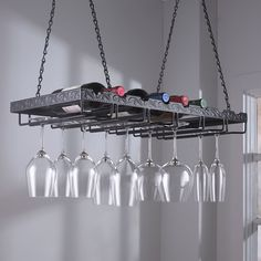 Display your stems in style above a table, kitchen island or wine bar. Holds up to 24 glasses & 8 bottles on top. Securely suspends from steel chains.