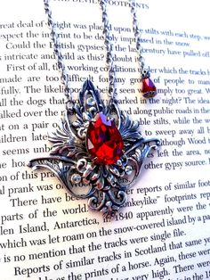 Hey, I found this really awesome Etsy listing at https://www.etsy.com/listing/124887505/gothic-silver-necklace-red-crystal