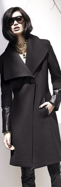 Black wide colour, single button with 3/4 wool sleave and leather trims... Elie Tahari Leather Trim Coat
