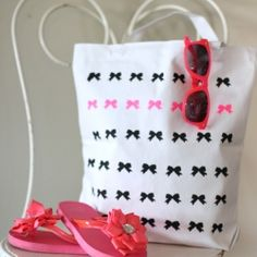 Create this cute project with a touch of neon using a canvas tote, freezer paper and a bow paper punch!!