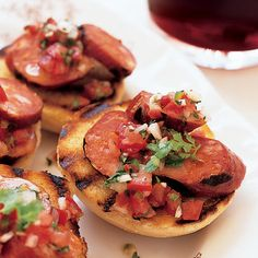 Grilled Chorizos with Salsa | These Chilean crostini give guests something to snack on while they're waiting for their grilled steaks and pork chops.