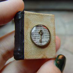 Miniature book with tiny brass key. erickav.com evminiatures