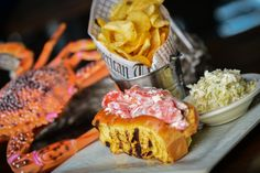New England Lobster Roll: 6 oz. shucked Maine lobster, lemon aioli, house slaw, butter toasted roll, Cape Codder potato chips (served hot or cold, spicy or plain).