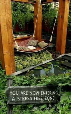 Love this. What a wonderful place to relax. The sign really makes it too --- I will make one for Spring front and back yard. Yeah