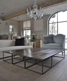 several coffee tables combined to make one very large coffee table