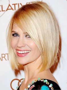 A wide side part is key to January Jones's precisely cut hairstyle, a sleek yet sexy version of the bob. via StyleList