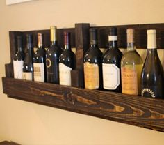 DIY Wine bottle shelf.  Love the wooden one.  Also has link to Etsy site where you can buy it if you're feeling lazy!