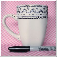 Hand Printed Mug This would make a great custom gift. The Dollar Store sells white mugs all the time. Use color sharpies or the classic black and white to give the mugs the look you love. You can add a package of hot chocolate inside and a little bag of marshmallows. ADORABLE!