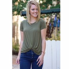 SOLD OUT • Green Twist Top Here's a twist to your favorite basic tee. Our Kelsey top is the softest tee that offers a twist front that's perfect to pair with your best mid-rise denim and our Coco Booties!  - 95% Rayon - 5% Spandex  Kaytlin is wearing a size small. So Damsel Tops Tees - Short Sleeve