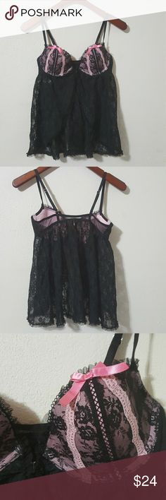 Victoria's Secret Sexy Little Things Babydoll 36B Front closure babydoll from Victoria's Secret Sexy Little Things collection. Black Lace with pink details on the cups, including innocent bows. Pushup within the cups adds volume to the chest. Adjustable straps. 36B. Victoria's Secret Intimates & Sleepwear